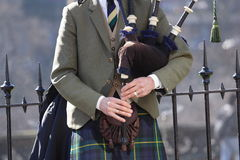 Playing bagpipes - landscape. Man playing bagpipes, wearing traditional costume stock photography