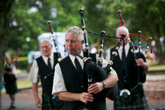 Playing the bagpipes. Royalty Free Stock Image