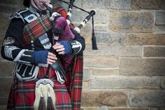 Playing the bagpipes on streets of Edinburgh Royalty Free Stock Photo
