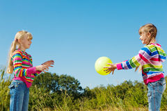 Playing the ball. Two kids playing the ball Royalty Free Stock Images