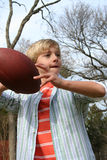 Playing Ball. Young cute boy playing football Stock Image