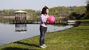 Playing ball near a lake stock video footage
