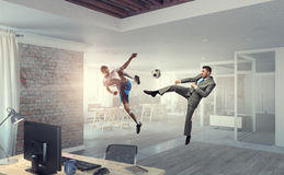 Playing ball in office . Mixed media Stock Photo