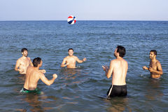 Playing ball in sea Royalty Free Stock Photo
