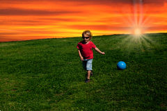 Playing ball at sunset Stock Photography