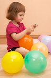 Playing with balloons Stock Photos