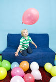 Playing with balloons Stock Image