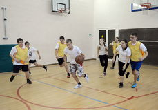 Playing basketball in gym class. Royalty Free Stock Photos