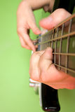 PLAYING THE BASS GUITAR Royalty Free Stock Photography