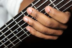 Playing bass guitar Royalty Free Stock Photos