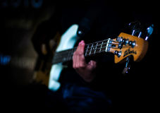 Playing Bass Guitar. Fingering to playing guitar and music Royalty Free Stock Photos