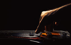 Playing a Bass Guitar. Male hand playing five strings jazz bass guitar Royalty Free Stock Image