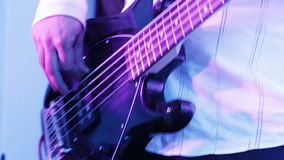 Playing the bass guitar stock video