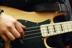 Playing bass guitar Royalty Free Stock Images