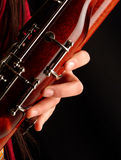 Playing bassoon. Close up to a hand playing bassoon Stock Photography