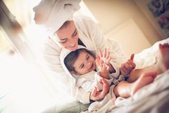 Playing after bath. Mother and daughter. Lifestyle royalty free stock image