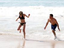 Playing on the beach. Young couple playing on the beach Stock Photography