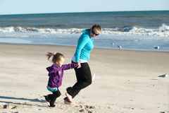 Playing at the beach. Mother and daughter playing at the beach Royalty Free Stock Photos