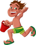 Playing in the beach. Boy with a green shorts running with a red bucket Stock Images