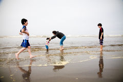 Playing at the beach Royalty Free Stock Photo