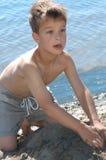 Playing at the beach. Boy playing at the beach Stock Photography