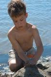 Playing at the beach. Boy playing at the beach Stock Photos