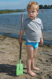 Playing at the beach. Young boy playing at the beacj Royalty Free Stock Photo