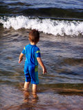 Playing on the beach. My son is ready to swim stock photography