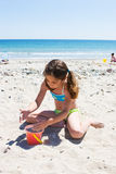 Playing on the beach. Fun in the sun and sand Royalty Free Stock Photo