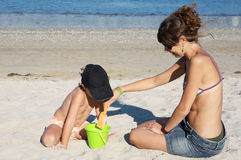 Playing on the beach Royalty Free Stock Photos