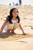 Playing On The Beach. A young hispanic girl enjoying sun and sand Royalty Free Stock Image