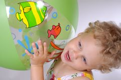 Playing with beach ball Stock Photo