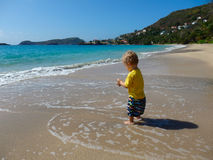 Playing on a beach in the caribbean Royalty Free Stock Images