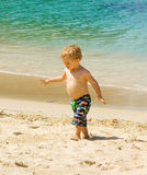Playing on a beach in the caribbean Royalty Free Stock Photo