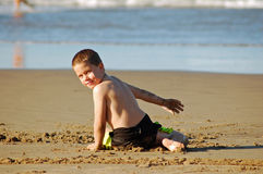 Playing in beach sand Royalty Free Stock Photos