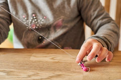 Playing with Beads and String. Royalty Free Stock Photo