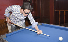 Playing billard Stock Images
