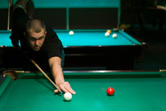 Playing in billiard Royalty Free Stock Photo