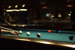Playing billiard. Aiming and shooting in pool game Stock Image