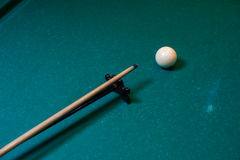 Playing billiard background, cue with snooker ball. Playing billiard background - cue with white snooker ball on green table Stock Image