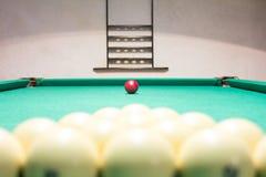 Playing billiard. Billiards balls and cue on green billiards tab Royalty Free Stock Photos