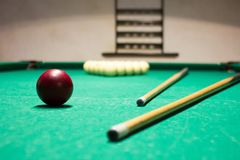 Playing billiard. Billiards balls and cue on green billiards tab stock images