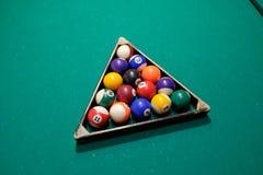 Billiard Pool Table with balls. Playing billiard. Billiards balls green billiards table. Billiard sport concept. Pool billiard game Stock Photo