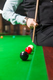 Playing billiard - Close-up shot of a man playing billiard Royalty Free Stock Photography