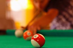 Playing in billiard pool activity. Royalty Free Stock Photography
