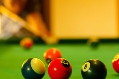 Playing in billiard pool activity. Stock Photography