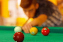 Playing in billiard pool activity. stock image
