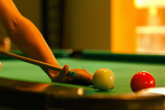 Playing in billiard pool activity. stock images
