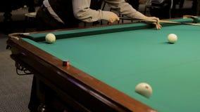 Playing billiard. shot of a man playing billiard stock footage