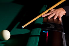 Playing billiards. With balls on a green felt table Stock Photo